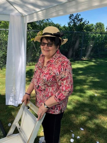 Jeanette couldn't resist trying on this adorable hat during the garden tour.