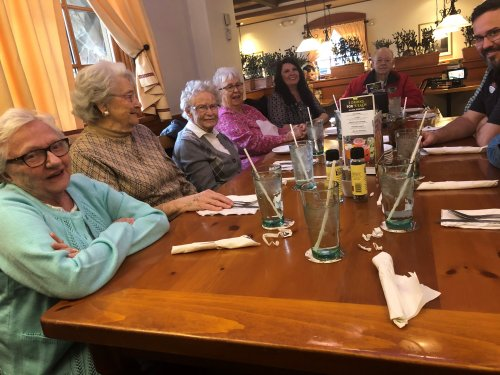 Everyone is all smiles at the Olive Garden lunch outing.