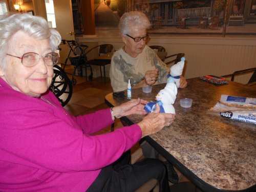 Joan M's is happy she could make a snowman without getting cold! Joan B is working studiously to get the face 'just so.'
