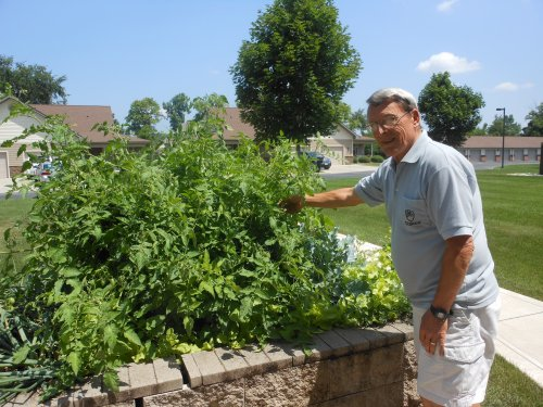 Mike shows off his green thumb!