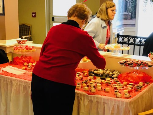 Janice enjoys deserts from our desert buffet on Valentine's Day