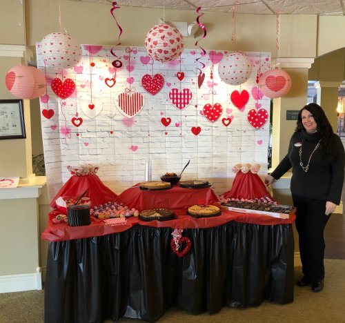 Our Executive Director opens up the dessert buffet on Valentines Day