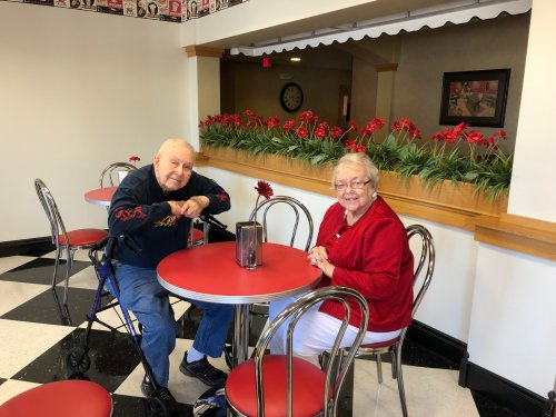 Carl and Barb enjoying warm cookies in the ice cream parlor.