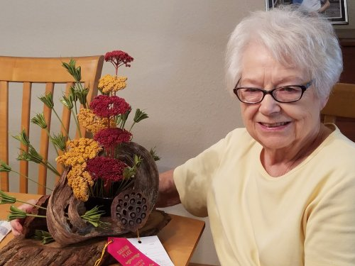 Miriam poses with one of her beautiful floral arrangments