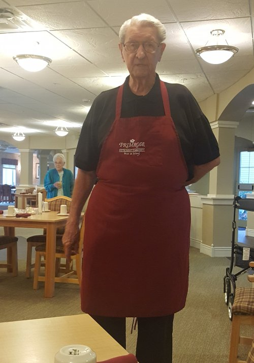 Don enjoys helping others in the dining room.