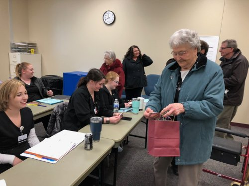 Rose delivering gift cards for nursing students on National Acts of Kindness day