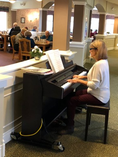 Karen, our administrative assistant enjoys playing the piano during lunch.