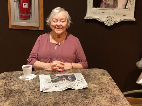 Barb enjoys her morning newspaper and coffee