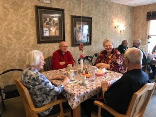 Residents enjoyed the shrimp served for their holiday luncheon