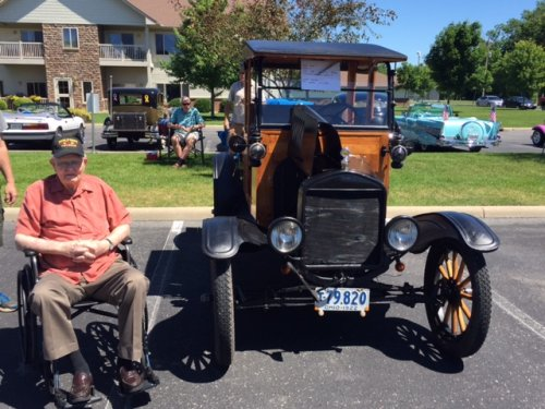 Corry Dickson is sitting beside a car that was made the same year he was born.