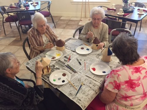 The craft for June was decorating bird houses and feeders to put outside their window.