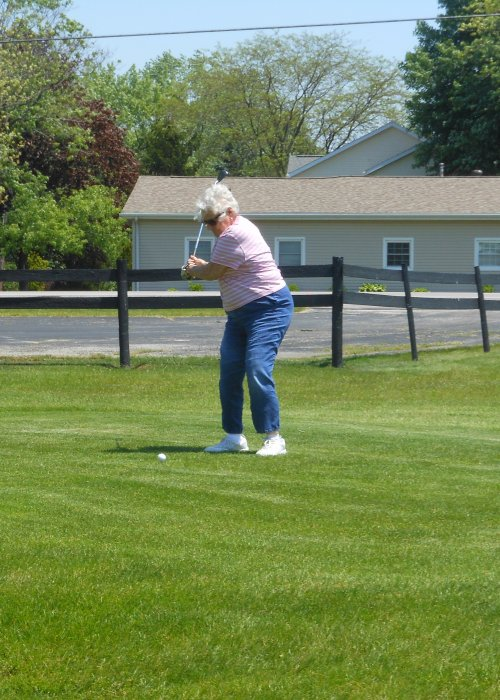 Wilma tees off at the first hole.