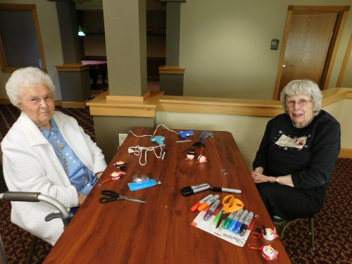 Ruth and Jean work on January's craft project.