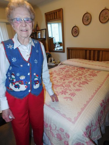 Ellen shows the cross-stitch hand-quilted quilt she made during this year's Tour of Homes.