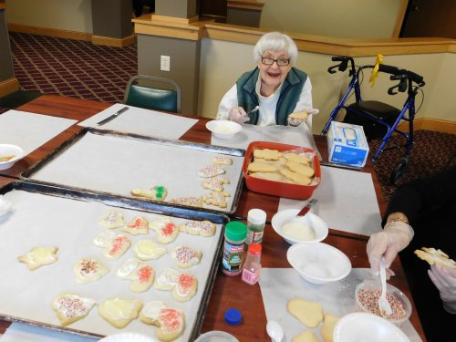 Grand Island's Resident Betty pitches in and helps decorate Christmas cookies for the Habitat for Humanity Cookie Walk.