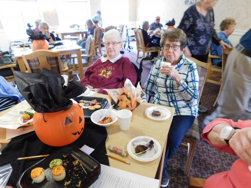 It's fun being with friends at Primrose.  Grand Island's Pat and Lu share in the Halloween party.