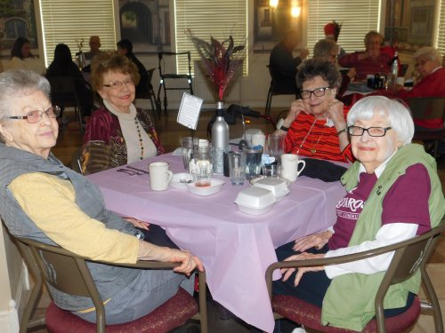Virginia, Norma, Elsie, and Betty share time together.