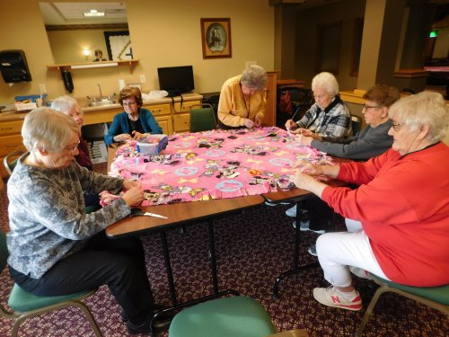 Busy tying blankets for our service project-blankets for a local homeless shelter.  Christmas is a time for giving!