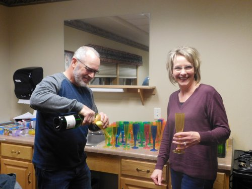 Charlie and Lisa do the 'honors'.  Can't celebrate the new year without champagne.