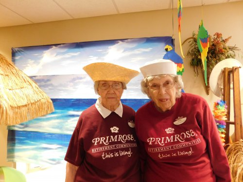 Beth and Jean, two of our Ambassadors, ready to do their part at our recent 'Sip and See' cruise ship Open House.