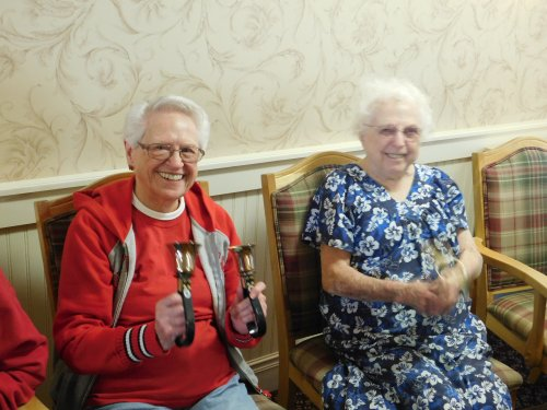 Grand Island Residents, Eva and Wauneta, try out some bells after the Union College Bell Choir performance.