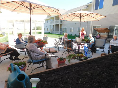 What fun to enjoy a beautiful day on the patio and work together to plant flowers.