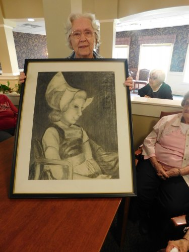 Beth shares a charcoal painting she did during our recent 'Show and Tell'.  What talented Residents we have!