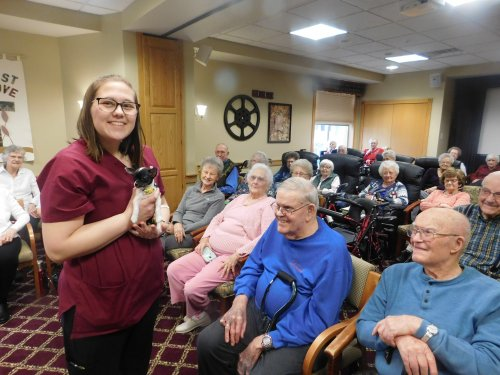 Our 2020 Primrose Family Variety Show was a BIG success.  Staff member Hope shares her special friend Sophie w/ the Residents.