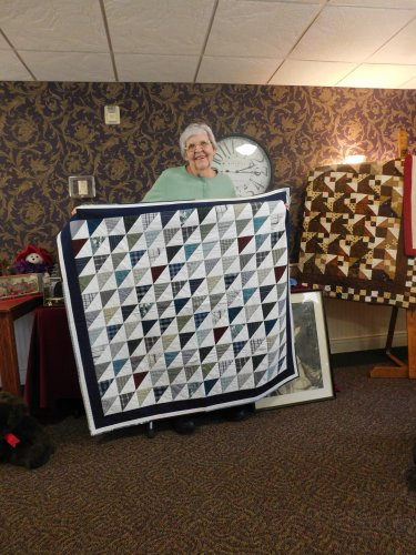 Darlene shares a quilt at our recent 'Show and Tell' made out of her late husband's shirts.  What a keepsake!