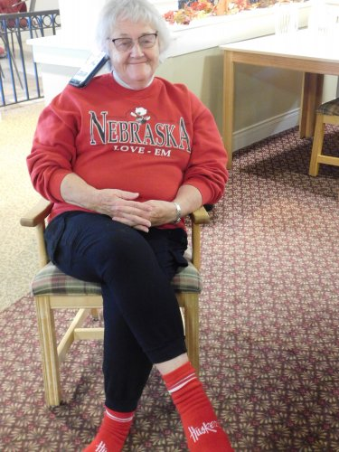 This is what a die-hard Husker fan does when she wants to get in on a special program at Primrose and yet listen to the football game at the same time.  Grand Island's Resident, Karen knows how to do it!