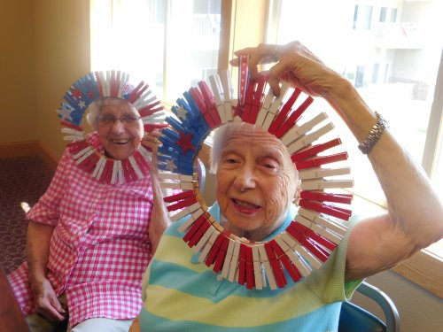 Friends, Betty and Gloria, model the Patriotic wreaths they made during Craft Day.  Don't they look cute!