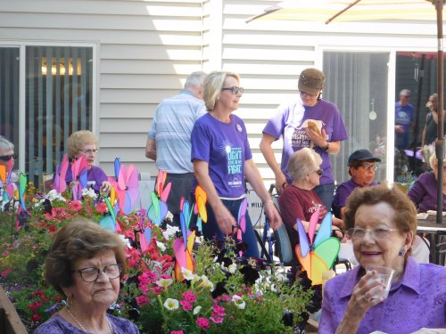Fun Patio Party for the Longest Day.  Everyone dressed in purple, entertainment, Alzheimer's Awareness pinwheels, refreshments and fun with friends!