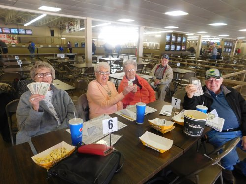 What a special group enjoying the horse races with money to show for it and smiles, as well!