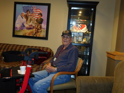 WWII Veteran, Ray, shares in the monthly Veterans' gathering in our Veterans' Honor Room.  These are our heroes!