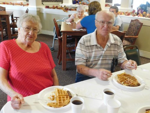 Cleo and Mona are enjoying our traditional 'Waffle Man' yummy treats for Grandparents' Day.