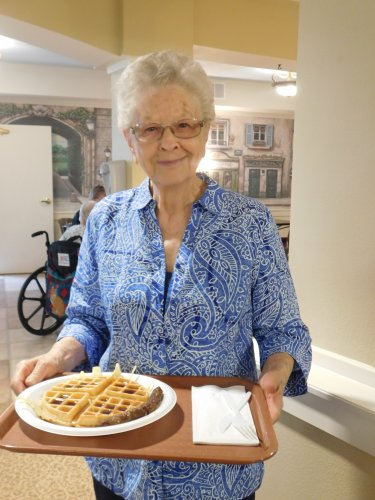 Virginia's ready to enjoy that delicious waffle. . . a Grandparent Day tradition!