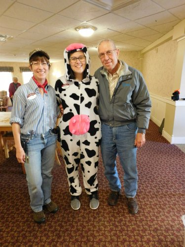 What Halloween Fun. . . the farmer, Harold, who lent clothes to the other farmer, Char and complete with the cow, Hope.  :)