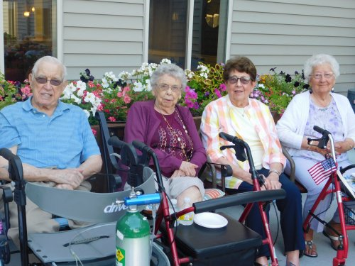Bill, Inez, Lu, and Marline are all smiles at the fun 'Patio Party' on a beautiful Nebraska evening!
