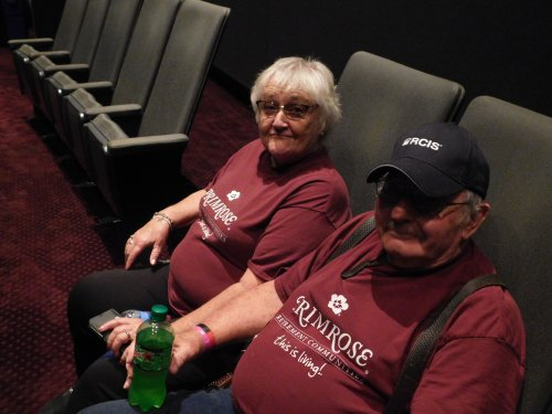 John and Karen waiting for the I-max Theater show and advertising Primrose at the same time.