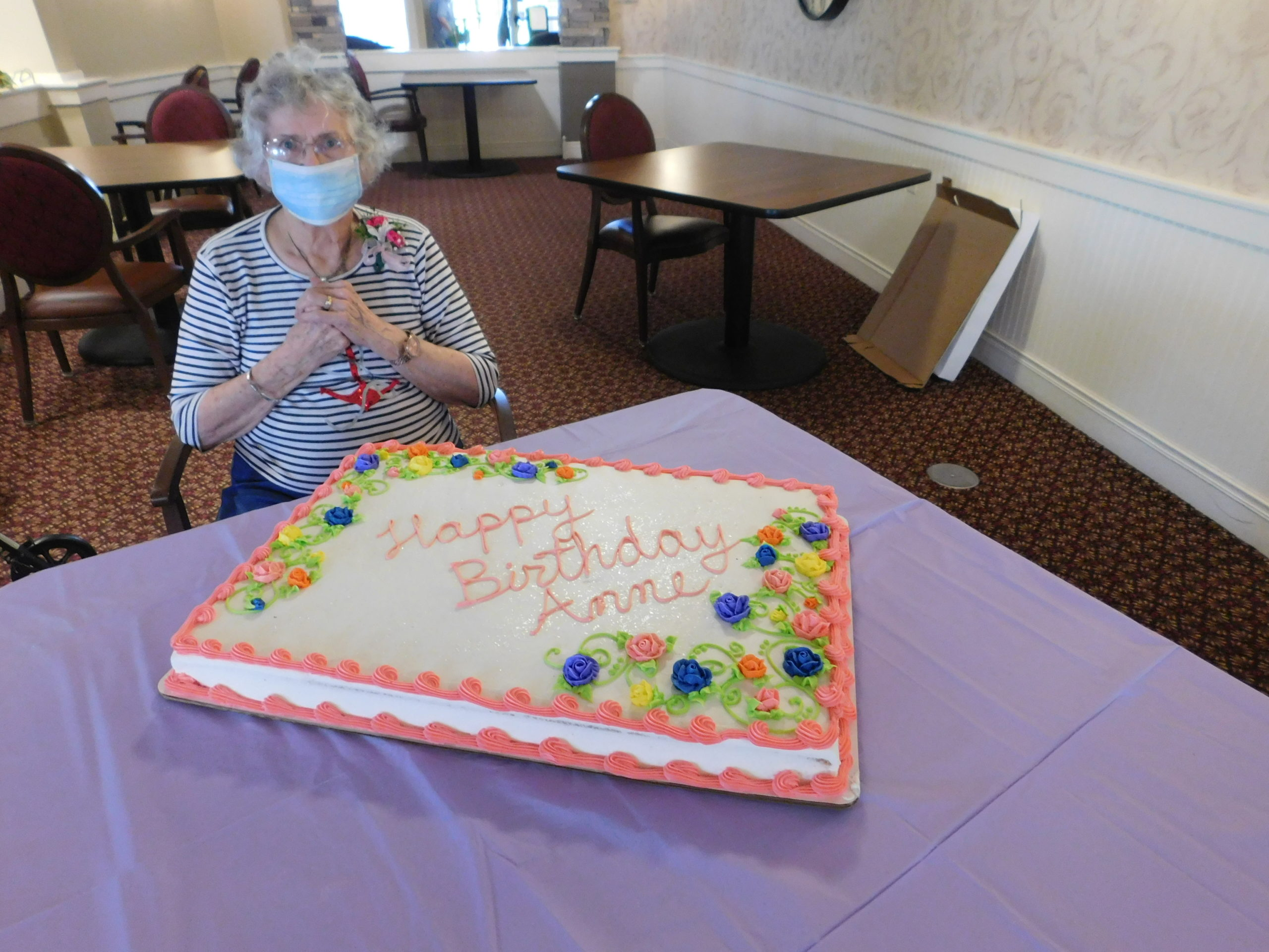 Anne's family shared a cake for the Primrose Residents so Anne enjoyed greeting everyone when they came to get a piece of her birthday cake in a