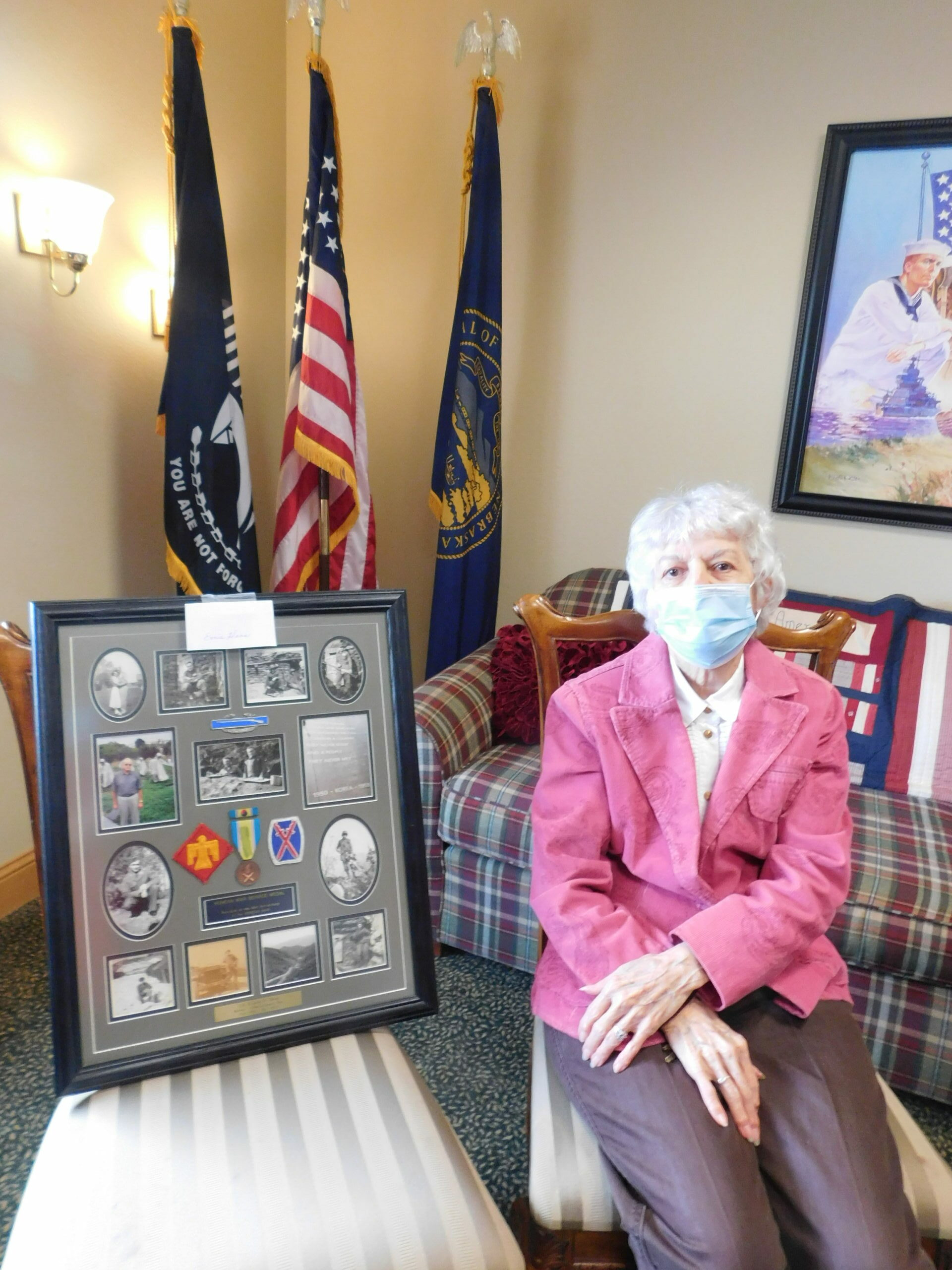 Joy shares a Veteran shadow box in honor of her husband, Ernie, with our Veterans.