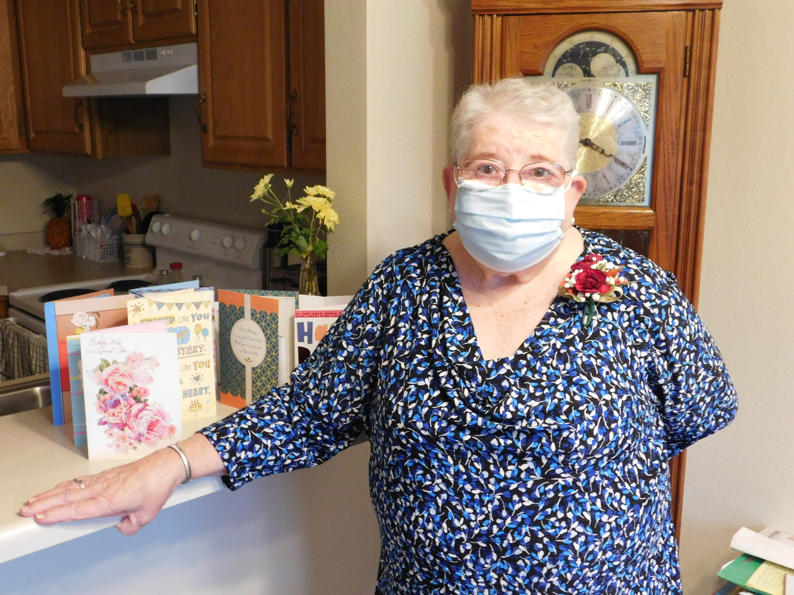 Roberta celebrated her birthday Covid-style.  Mask, corsage and cards from Friends.  These Residents are