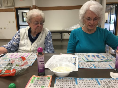 Helen and Sharon are concentrating hard to win the jackpot at our local Knights of Columbus bingo