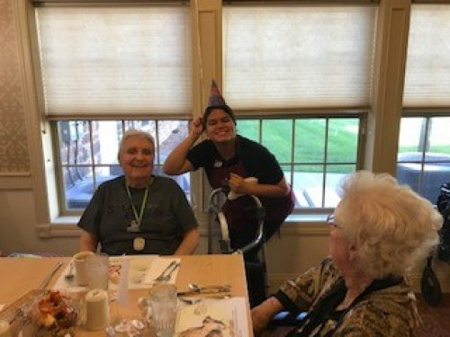 Residents help Sharon, dietary aid, celebrate her birthday!