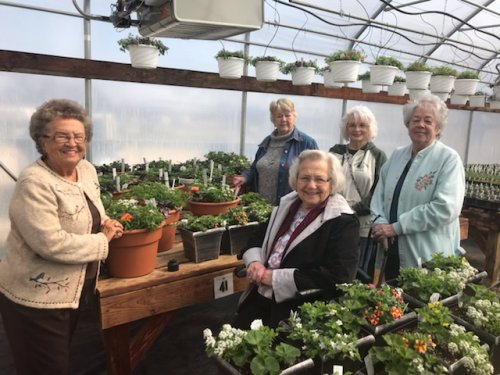 The ladies are enjoying their trip to the Master Gardner's greenhouse