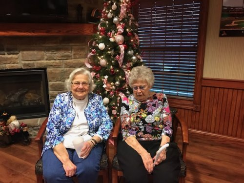 Friends, Cyrilla and Avis sat to take a picture in front of our beautiful Christmas tree