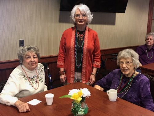 Ann, Sharon and Judy enjoyed their king cake and beads on Fat Tuesday.