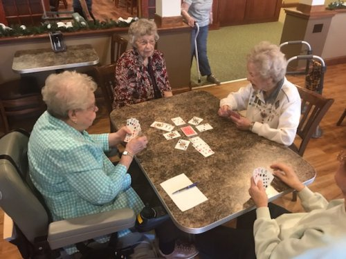 The ladies are enjoying a fun game of Kings on the Corner!