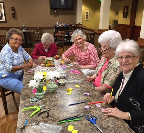 The ladies of Primrose are making spring centerpieces for our dining room tables.