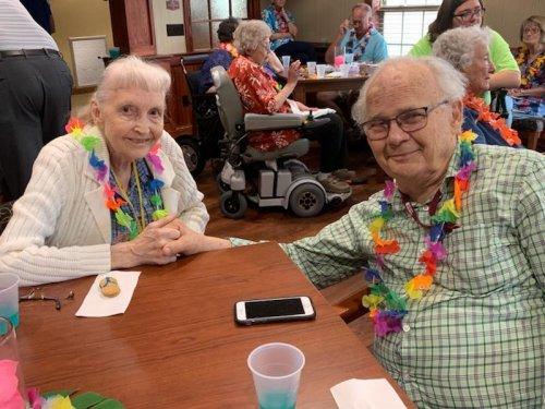 Danny and Margaret are having a blast at our Grandparent's Day luau!